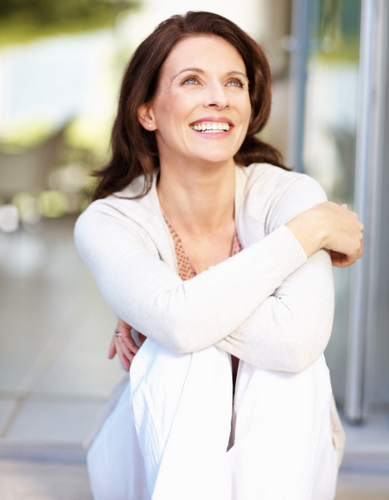 Dental Implant Solutions Smiling Woman Hugging Knees